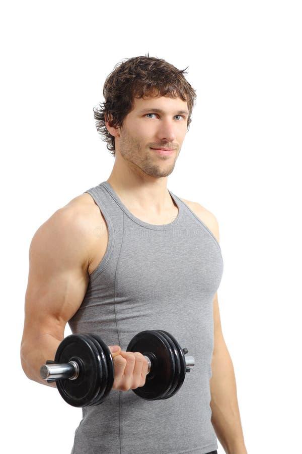 Aantrekkelijke en atletische mens die gewichten doen stock afbeeldingen