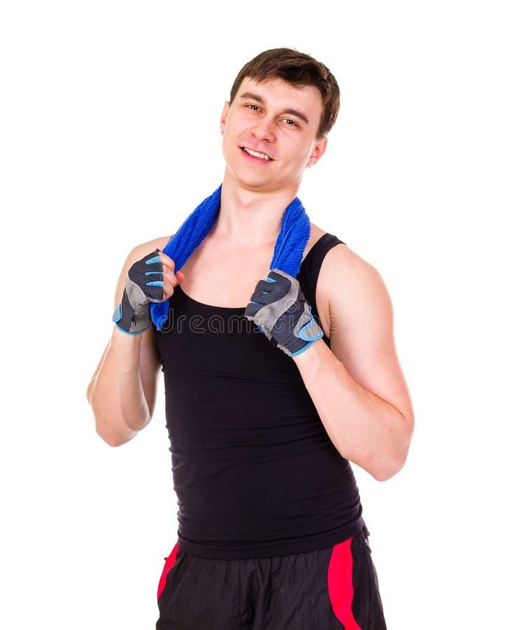 Aantrekkelijke geschiktheidsmens in sportkleding die op wit wordt geïsoleerd royalty-vrije stock foto's