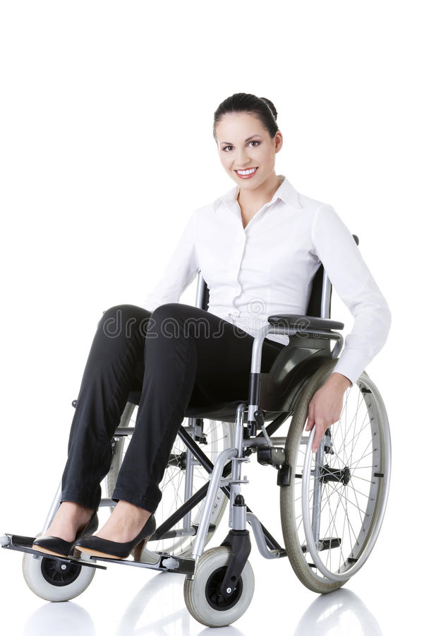 Aantrekkelijke glimlachende gehandicapte onderneemster stock foto