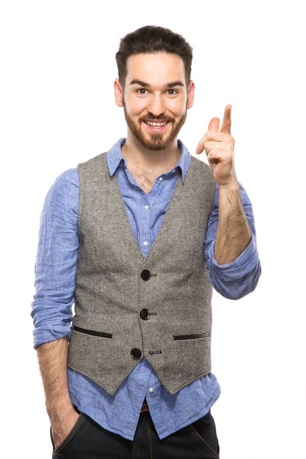 Aantrekkelijke jonge kerel die op mobiel spreken geïsoleerd op wit stock fotografie