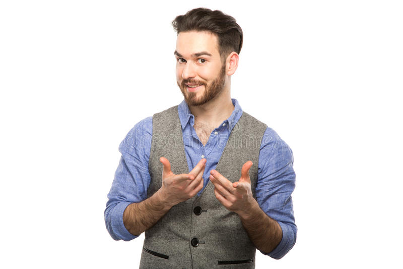 Aantrekkelijke jonge kerel die op mobiel spreken geïsoleerd op wit royalty-vrije stock fotografie