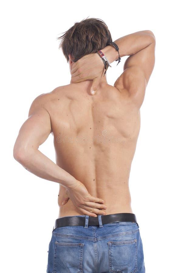 Aantrekkelijke jonge mens met rugpijn stock foto