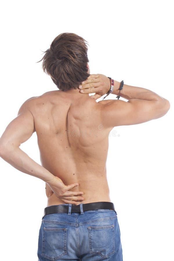 Aantrekkelijke jonge mens met rugpijn stock foto's