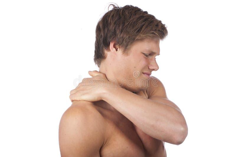 Aantrekkelijke jonge mens met schouderpijn royalty-vrije stock afbeelding