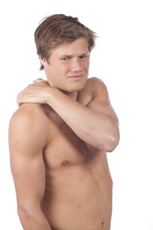 Aantrekkelijke jonge mens met schouderpijn stock foto