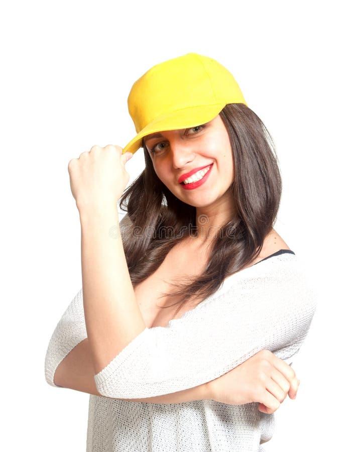Aantrekkelijke jonge vrouw die een geel honkbal GLB dragen stock foto's