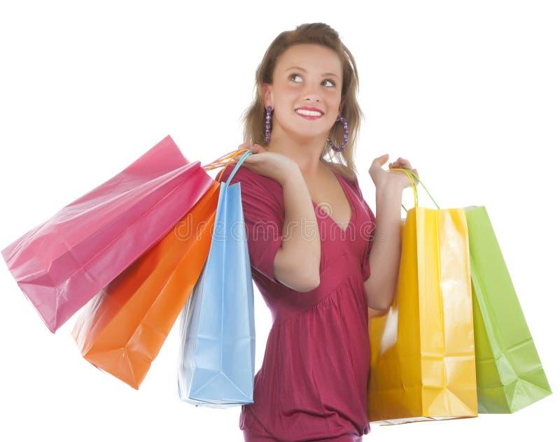 Aantrekkelijke jonge vrouw die verscheidene shoppingbag houdt royalty-vrije stock foto's