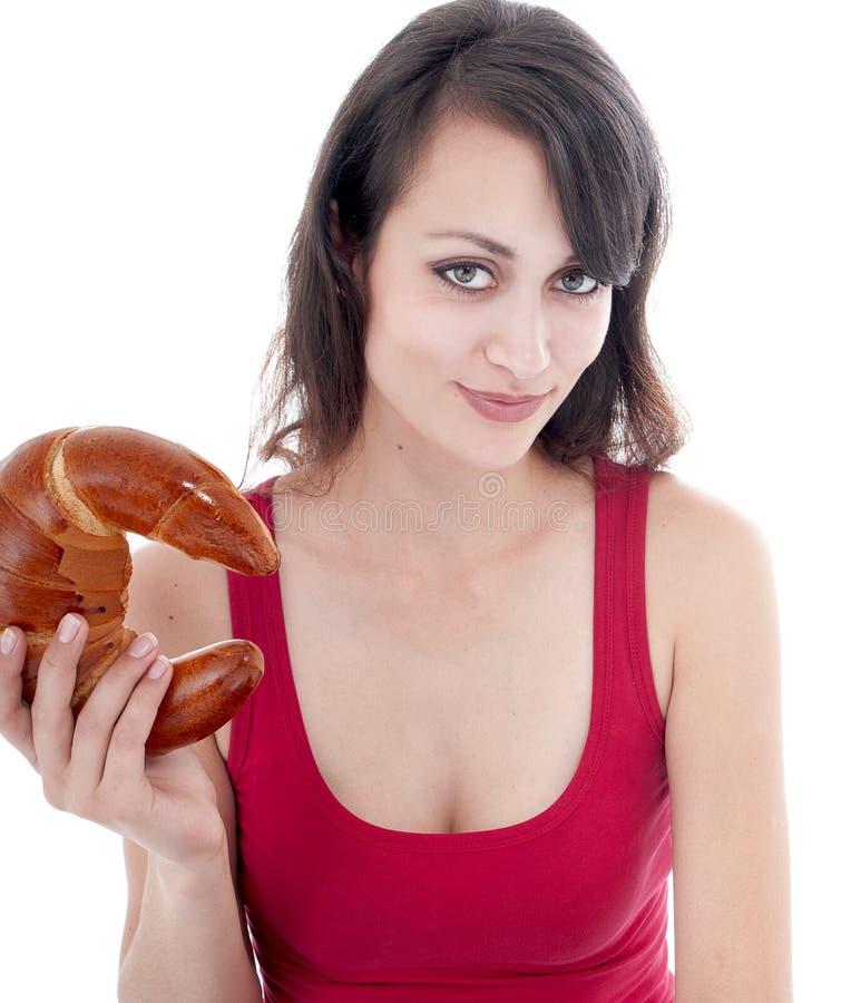 Aantrekkelijke jonge vrouw met ongezuurd broodje royalty-vrije stock afbeeldingen