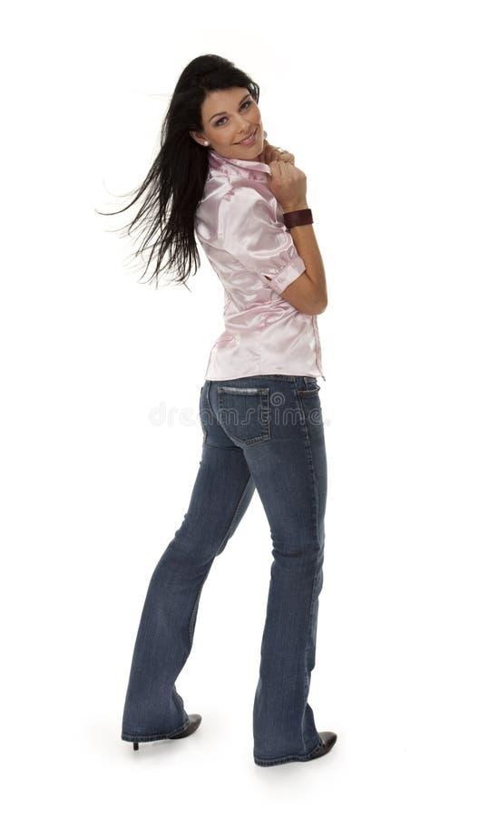 Aantrekkelijke Jonge Vrouw in Strakke Jeans stock afbeelding
