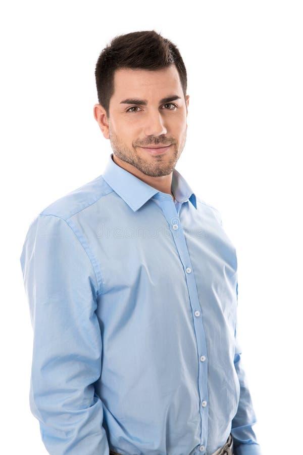 Aantrekkelijke jonge zakenman die blauw die overhemd dragen over wh wordt geïsoleerd stock foto's