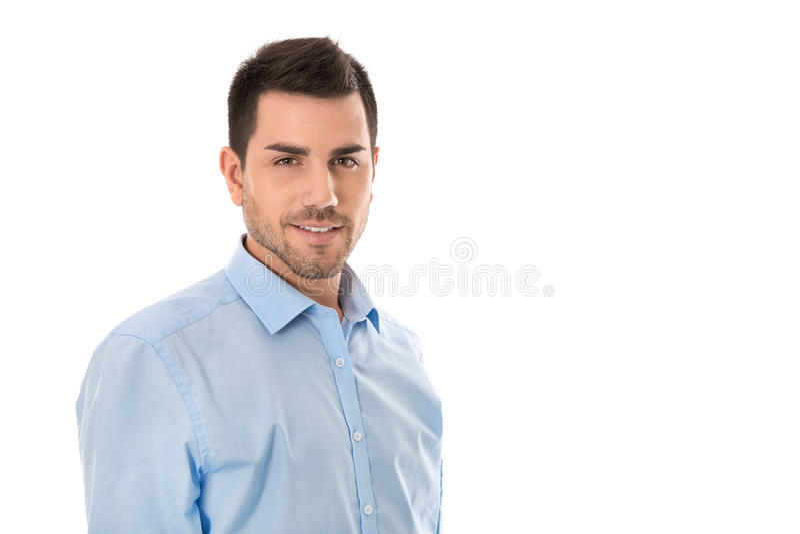 Aantrekkelijke jonge zakenman die blauw die overhemd dragen over wh wordt geïsoleerd royalty-vrije stock afbeelding