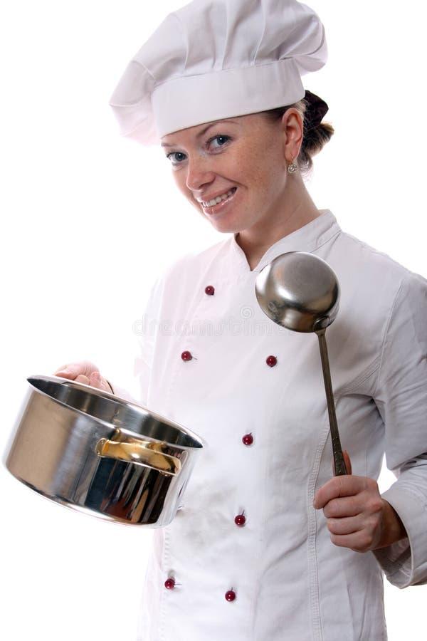 Aantrekkelijke kokvrouw stock afbeeldingen