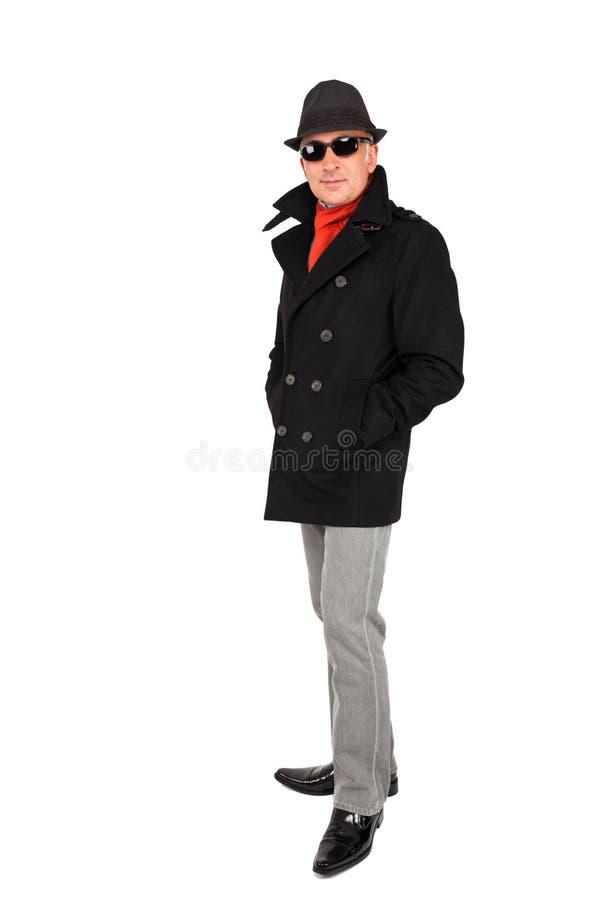 Aantrekkelijke mens die een erwtenlaag dragen stock foto's
