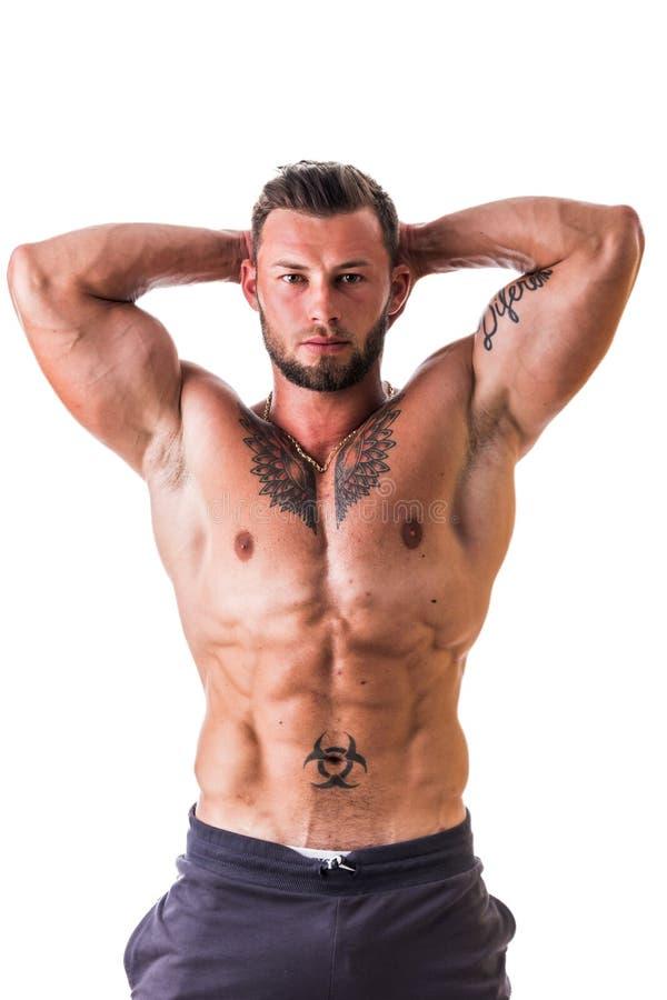 Aantrekkelijke shirtless muscleman op wit stock foto's