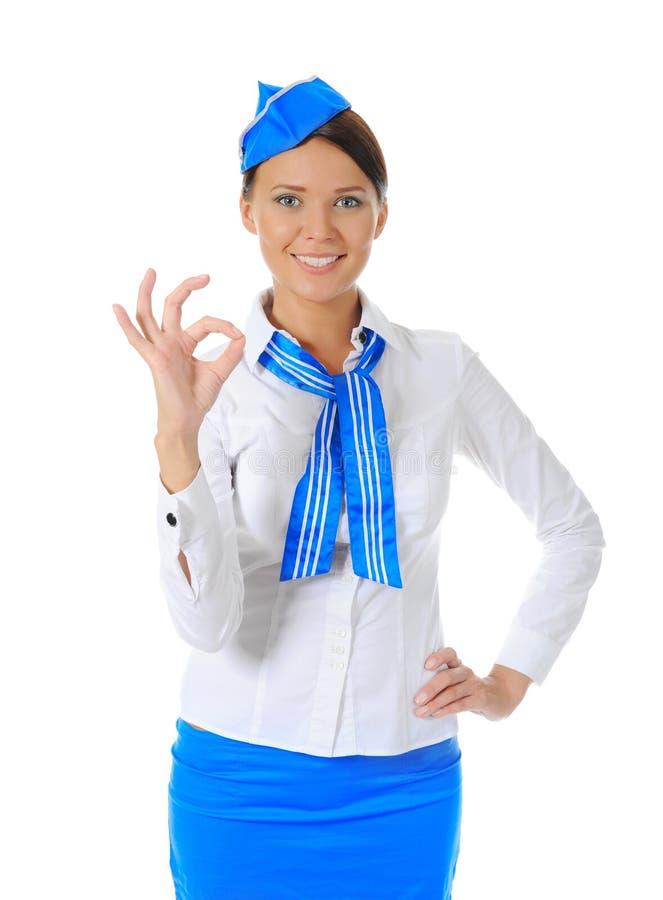 Aantrekkelijke stewardess stock afbeeldingen