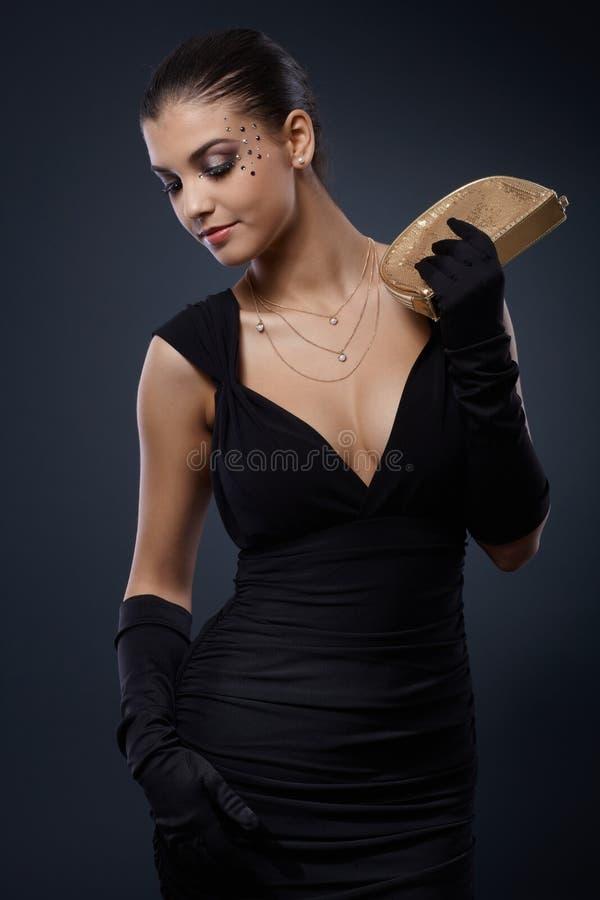 Aantrekkelijke vrouw in avondjurk royalty-vrije stock foto