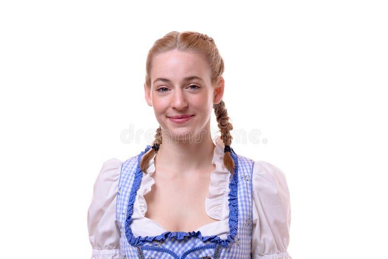 Aantrekkelijke vrouw die een traditionele Dirndl dragen royalty-vrije stock foto's