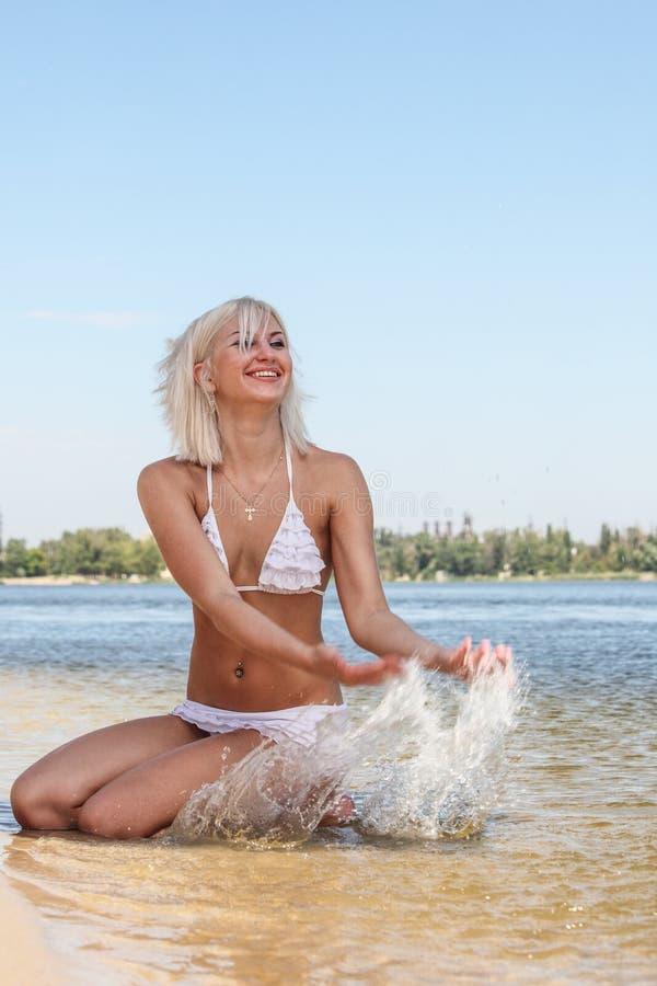Aantrekkelijke vrouw in het zwempak stock foto's
