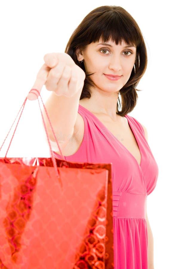 Aantrekkelijke vrouw met het winkelen in de rode kleding stock fotografie
