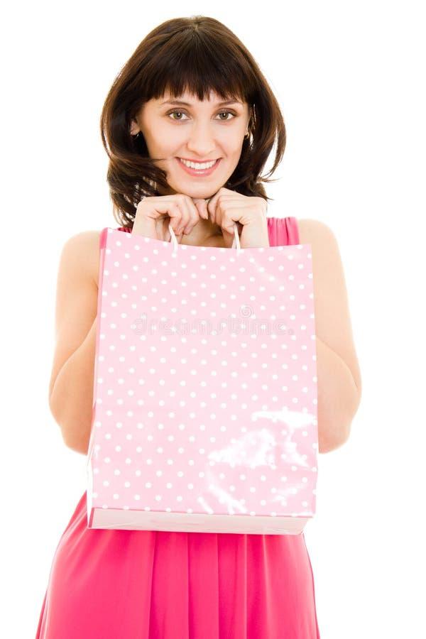 Aantrekkelijke vrouw met het winkelen in de rode kleding stock afbeeldingen