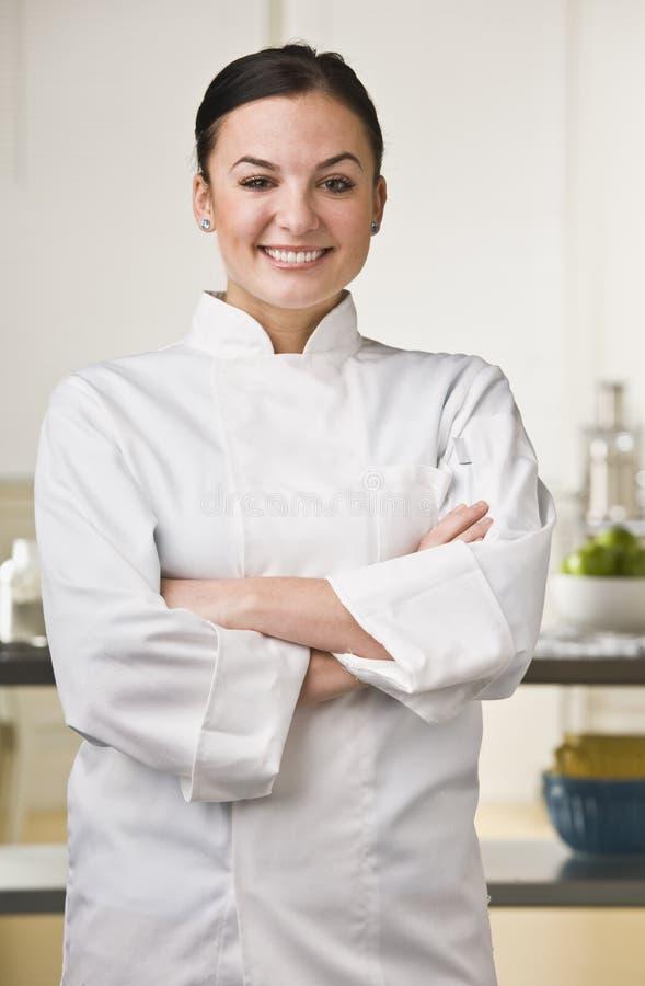 Aantrekkelijke vrouwelijke chef-kok. stock foto's