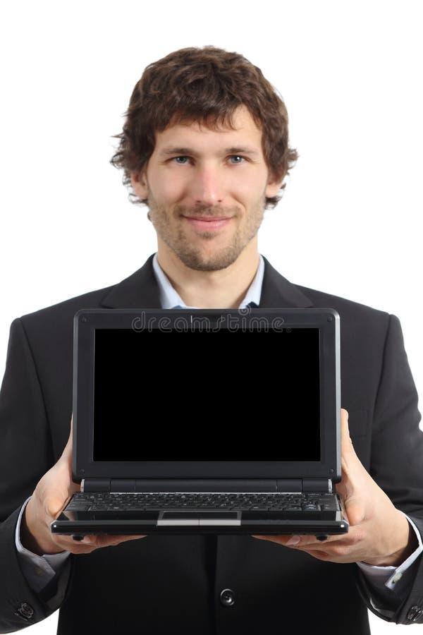 Aantrekkelijke zakenman die het netbookscherm app tonen royalty-vrije stock foto