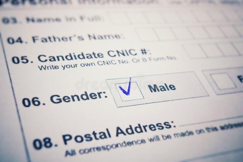 Aanvraagformulier - controleer mannetje of wijfje er is een tik op MANNETJE stock foto's