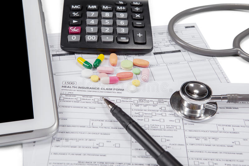 Aanvraagformulier om ziektekostenverzekering te eisen stock foto's