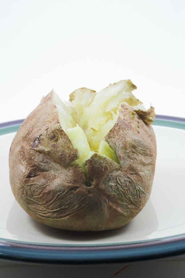 Aardappel in de schil stock foto's