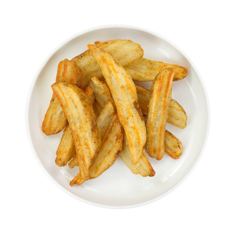 Aardappel in de schilwiggen in kleine schotel stock afbeelding