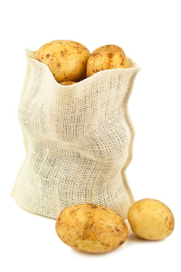 Aardappel in een zak stock afbeelding