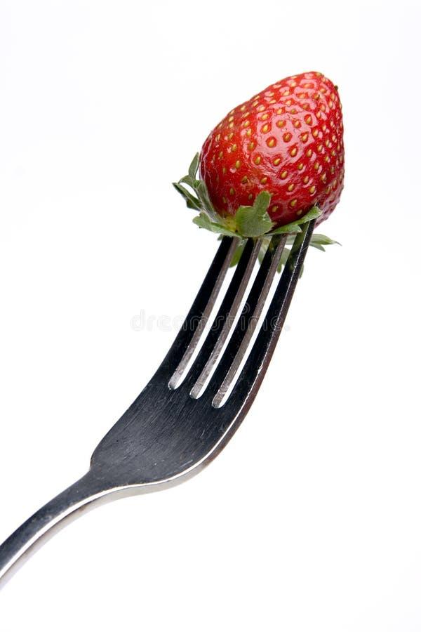 Aardbei op een vork stock foto