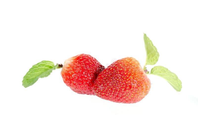 Aardbeien. Geïsoleerd op een witte achtergrond. stock afbeeldingen