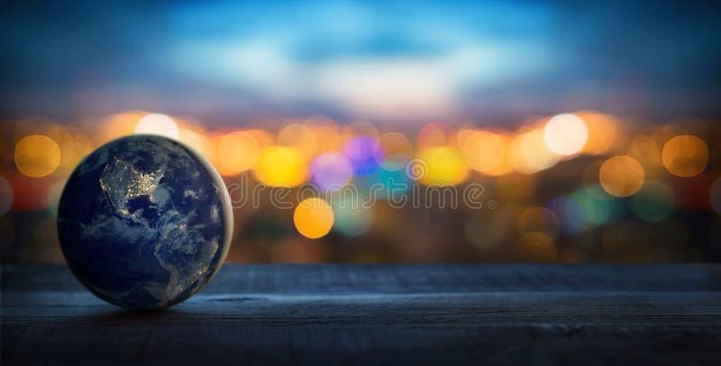 Aarde op de achtergrond van vage lichten van de stad Concept op zaken, politiek, ecologie en media De samenvatting van de aardeda stock foto's