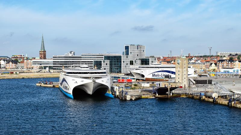 High-speed ferries EXPRESS 1 und EXPRESS 2 of the shipping company Molslinjen are moored in the port of Aarhus Denmark. Aarhus, Denmark - July 20, 2017: The high royalty free stock photography