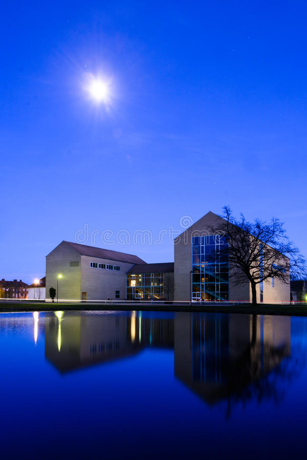 Aarhus University campus - evening blue. The campus of Aarhus University, Denmark, is recognized as a modernist architectural masterpiece, and yet tourists may stock photos