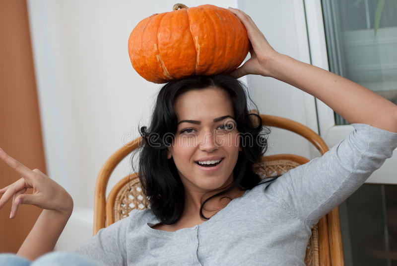 Download AAttractive Girl With Holding Pumpkins  In Here Ha Stock Image - Image: 12134773
