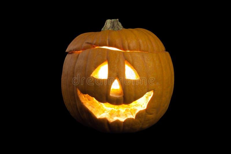 Abóbora cinzelada de Halloween Fundo preto imagem de stock royalty free