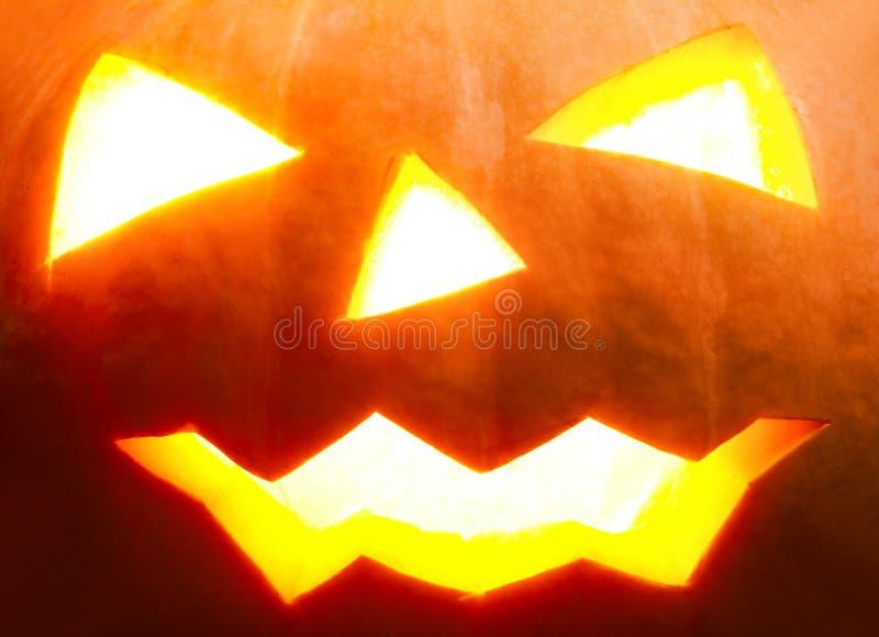 Abóbora de Halloween com o close-up assustador da face imagem de stock