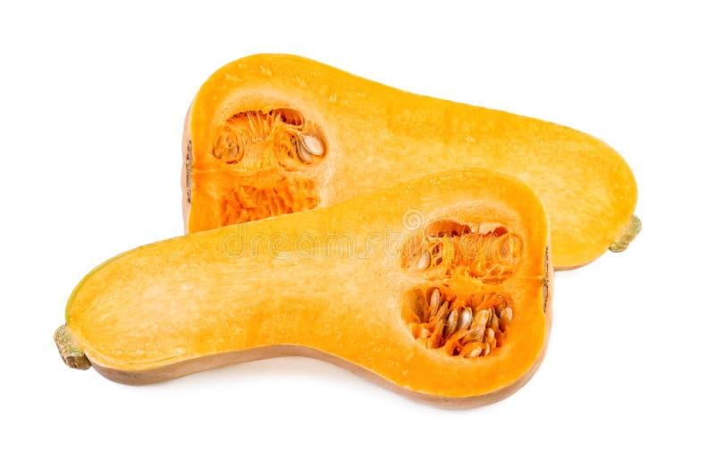 Abóbora do Butternut partida ao meio Duas metades da polpa de butternut isoladas no fundo branco fotos de stock royalty free