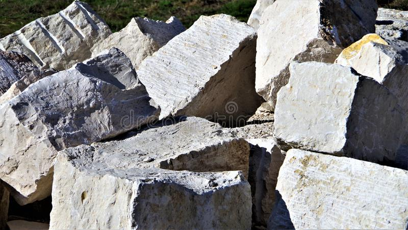 Limestone blocks for garden wall. Ab-loaded natural stone blocks for garden design, roughly worked Jura-wall Stones, pale yellow natural bricks, natural building royalty free stock photography