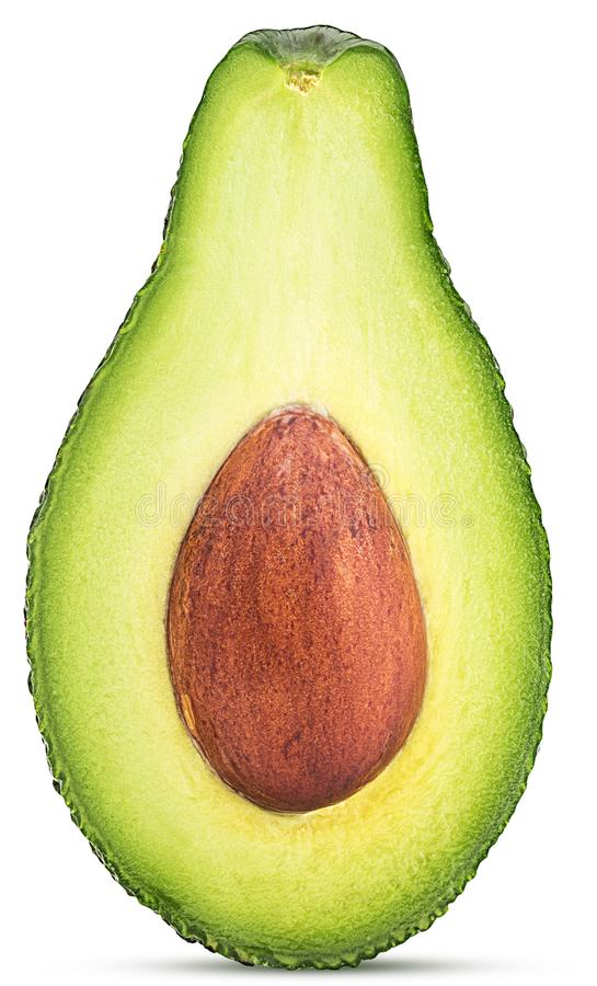 Abacate cortado dentro parcialmente imagens de stock