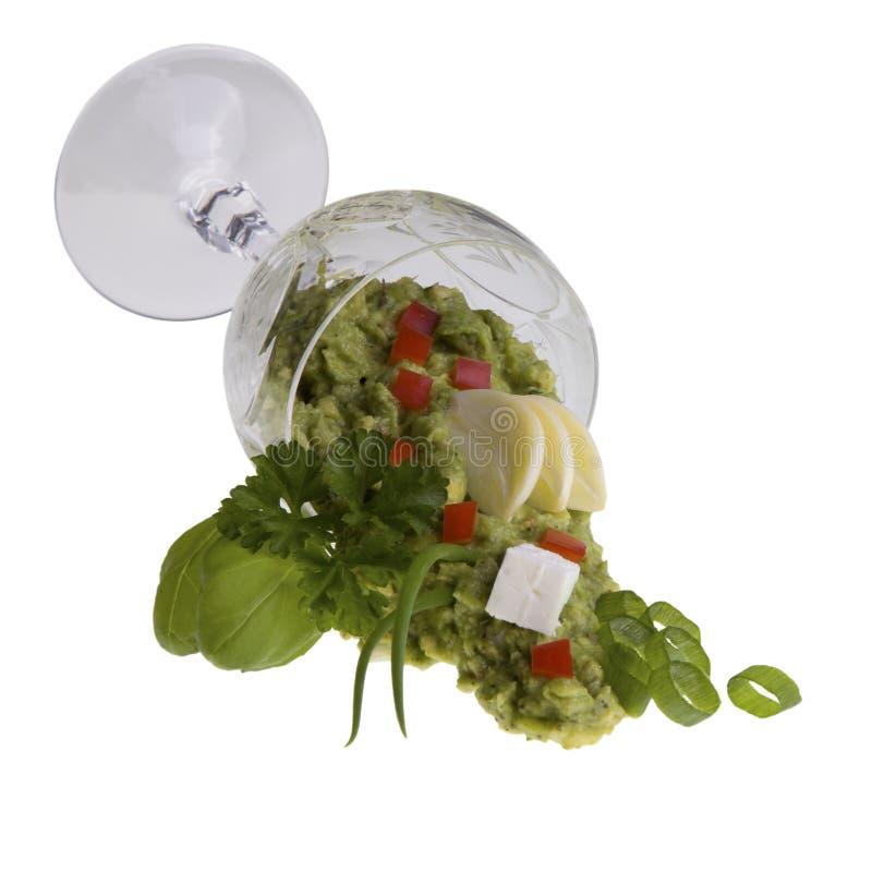 Abacate-creme no copo de vinho de encontro fotografia de stock royalty free