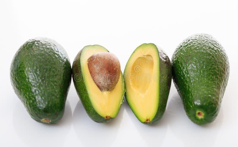 Abacates isolados no fundo branco imagem de stock