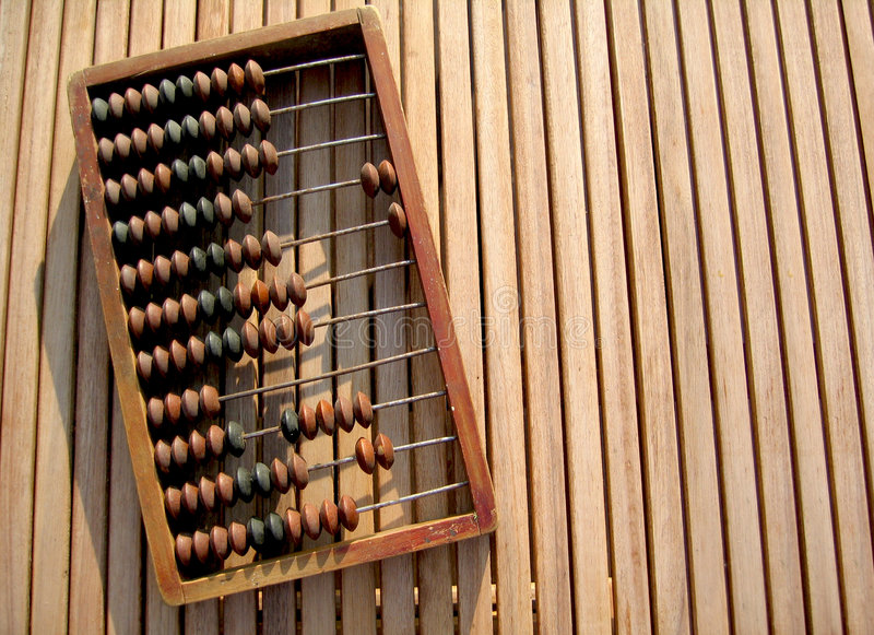 Vintage wooden abacus. Old timber abacus used for cost, tax and other calculations in many businesses stock images