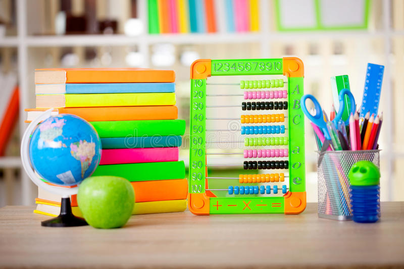 Abacus,globe, books and pencils on table,back to s stock photo