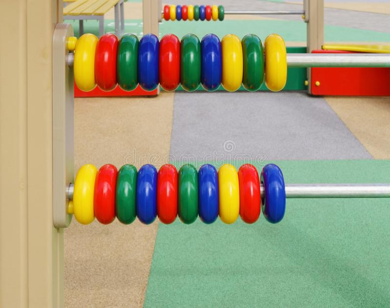 Abacus on playground royalty free stock photography
