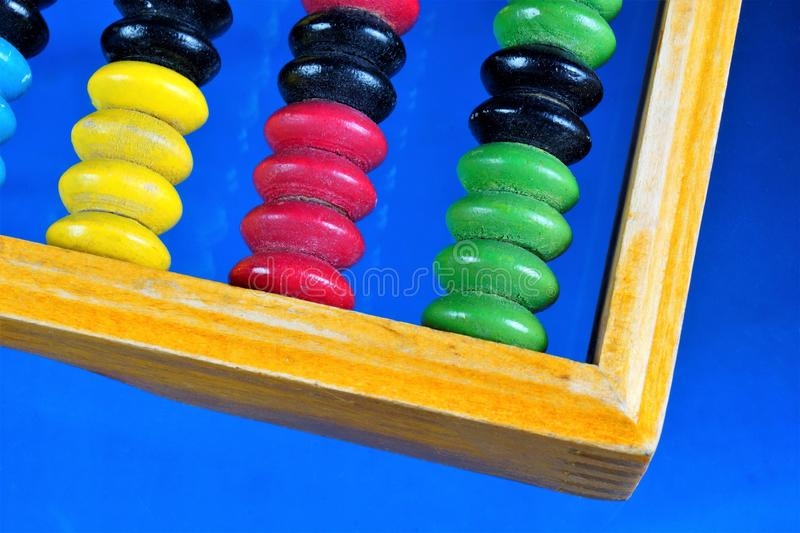 Abacus is a retro computing mechanical device. Abacus — vintage computer mechanical device, a counting Board with bones to. Perform accounting royalty free stock photos