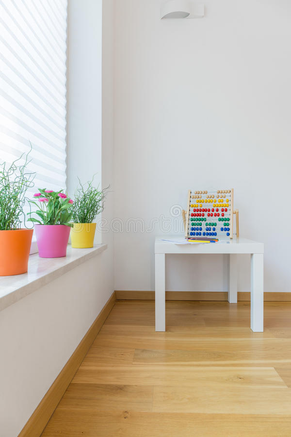 Abacus on table in child room royalty free stock photo