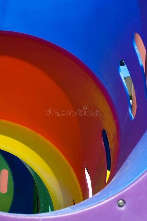 Abajo de la diapositiva del arco iris - correcta imagen de archivo